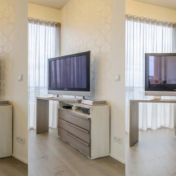 Daukiafunkcinė tv komoda - patogus tv žiūrėjimas nuo sofos ir nuo pietų stalo